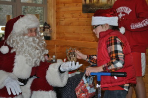 Johnny showing Santa the trophy he won!
